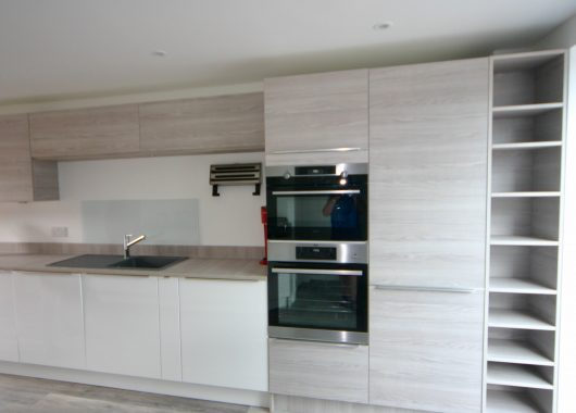 Soft white matt and textured wood effect kitchen